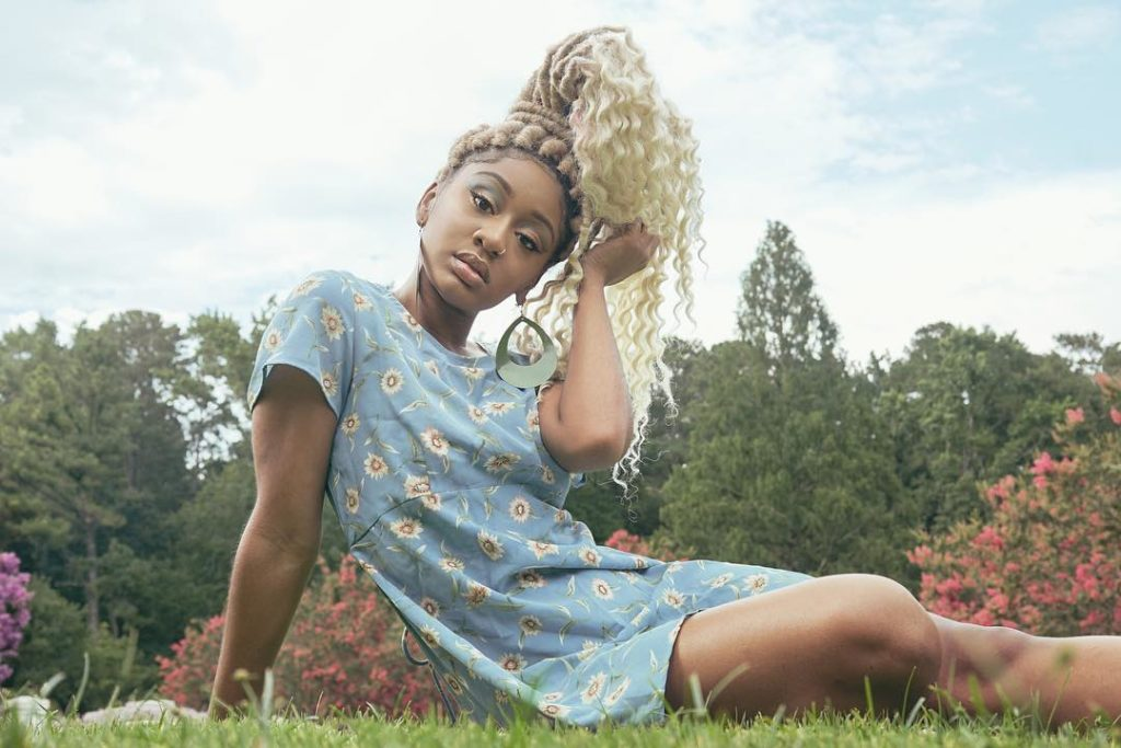 Blonde Faux Locs Updo With Curly Ends
